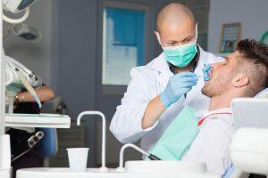 pasang gigi palsu permanen